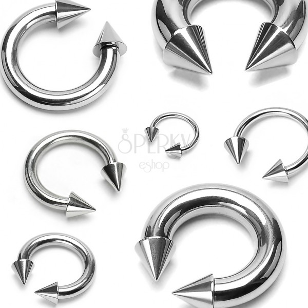 Stainless steel piercing of silver colour - horseshoe finished with pikes
