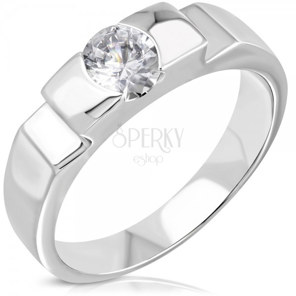 Engagement ring with protruding centre and side cuts