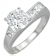 316L steel ring with asymmetrically imbedded zircons