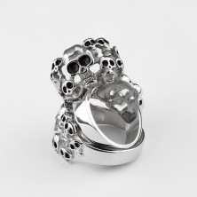 Steel 316L ring of silver colour - ten skulls with glaze of black colour