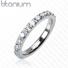 Titanium ring with embedded clear zircons