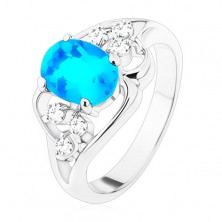 Ring in silver colour, big blue oval zircon, asymmetric lines