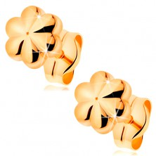 Stud earrings made of yellow 14K gold - small shiny flower with notches