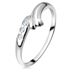 Ring made of white 14K gold - bent shoulder with notch and triplet of clear zircons