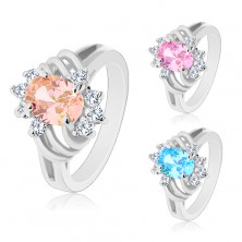 Glossy ring in silver colour, big coloured oval, thin arcs and clear zircons