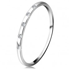 Ring made of white 14K gold - five tiny clear diamonds, thin band