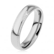Ring made of 316L steel, silver hue, shiny centre and notched borders