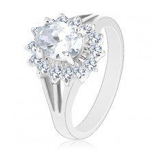 Ring with split shoulders, oval zircon flower in clear colour