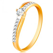 585 gold ring with divided bicoloured shoulders, clear zircons