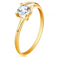 Ring made of yellow 14K gold - thin divided lines of shoulders, sparkly clear zircon