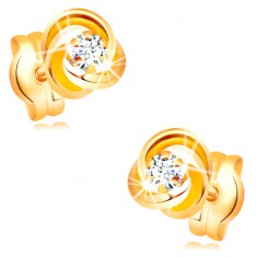 Earrings made of yellow 585 gold - knot composed of three hoops, clear zircon in the middle