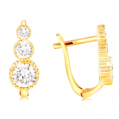 Earrings made of yellow 14K gold - clear zircon snowman, notched edges