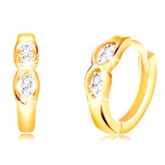 14K gold earrings with hinged snap fastening - two oval cuts with clear zircons