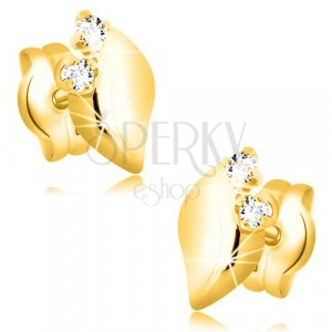 Yellow 14K gold earrings - glossy leaf with two clear zircons
