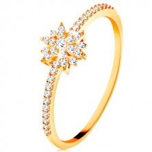 Ring made of yellow 9K gold - sparkly flower composed of clear zircons, glossy shoulders