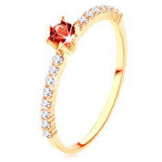375 gold ring - clear zircon lines, raised round red garnet