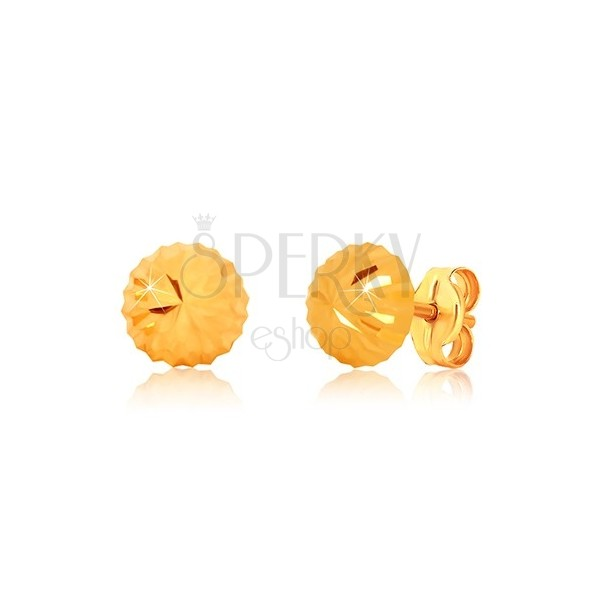 Yellow 375 gold earrings, flower motif - glittery head with cuts, studs