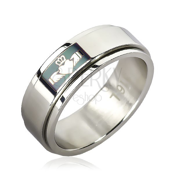 Steel ring with Claddagh design on green background