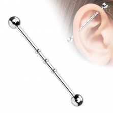 Industrial piercing with three small rings and ball heads